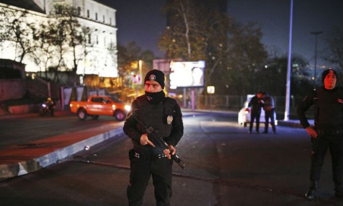 Turkish police officers cordon off the roads leading to the area of the Besiktas football club stadium, in Istanbul, late Saturday, Dec. 10, 2016. Two loud explosions have been heard near the newly built soccer stadium and witnesses at the scene said gunfire could be heard in what appeared to have been an armed attack on police. Turkish authorities have banned distribution of images relating to the Istanbul explosions within Turkey. (AP Photo/Emrah Gurel) TURKEY OUT