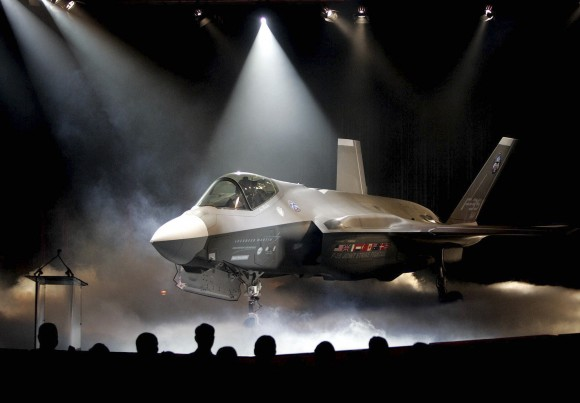 """The Lockheed Martin F-35 Joint Strike Fighter is shown after it was unveiled in a ceremony in Fort Worth, Texas in this July 7, 2006, file photo. Shares of Lockheed Martin fell Monday, Dec. 12, 2016, as President-elect Donald Trump tweeted that making F-35 fighter planes is too costly and that he will cut """"billions"""" in costs for military purchases. (AP Photo/LM Otero, File)"""