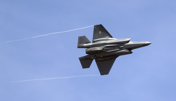 """An F-35 jet arrives at its new operational base at Hill Air Force Base, in northern Utah in this Sept. 2, 2015, file photo. Shares of Lockheed Martin fell Monday, Dec. 12, 2016, as President-elect Donald Trump tweeted that making F-35 fighter planes is too costly and that he will cut """"billions"""" in costs for military purchases. (AP Photo/Rick Bowmer, File)"""
