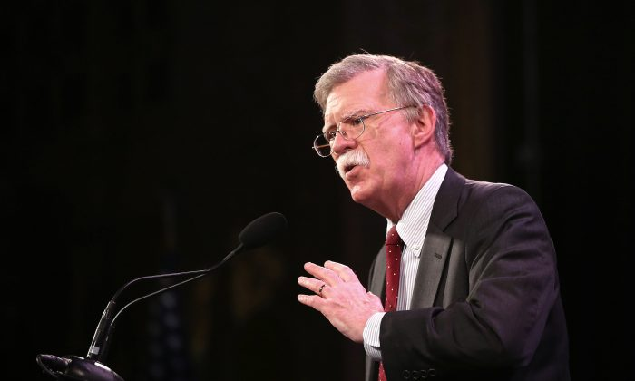 "Former Ambassador to the United Nations John Bolton speaks to guests at the Iowa Freedom Summit in Des Moines, Iowa on Jan. 24, 2015. Bolton has suggested allegations of Russia hacking the elections could be a ""false flag."" (Scott Olson/Getty Images)"
