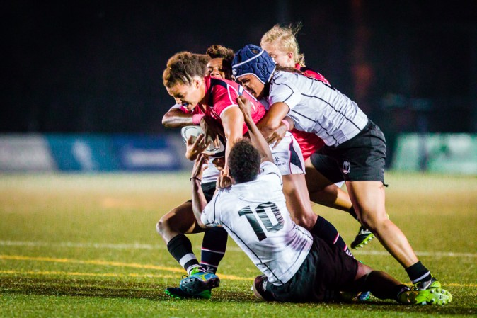 Hong Kong's Natasha Olson-Thorne battles towards the Fiji line in their World Cup qualifier match at King's Park on Friday Dec 9, 2016. (Dan Marchant)