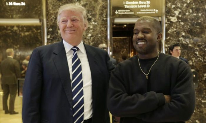 President-elect Donald Trump and Kanye West pose for a picture in the lobby of Trump Tower in New York on Dec. 13, 2016. (AP Photo/Seth Wenig)
