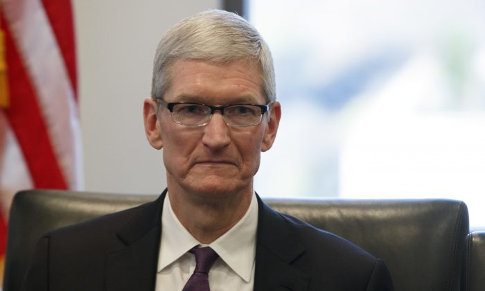Apple CEO Tim Cook listens as President-elect Donald Trump during a meeting with technology industry leaders at Trump Tower in New York, on Dec. 14, 2016. (AP Photo/Evan Vucci)