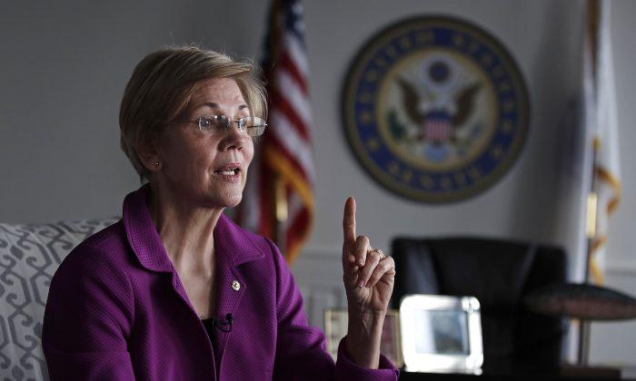Sen. Elizabeth Warren, D-Mass. during an interview at her office in Boston on Dec. 15, 2016. (AP Photo/Charles Krupa)