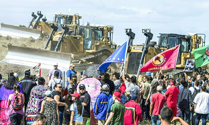 Members of the Standing Rock Sioux Tribe and their supporters confront bulldozers working on the Dakota Access Pipeline near Cannon Ball, N.D., on Sept. 3. (ROBYN BECK/AFP/Getty Images)