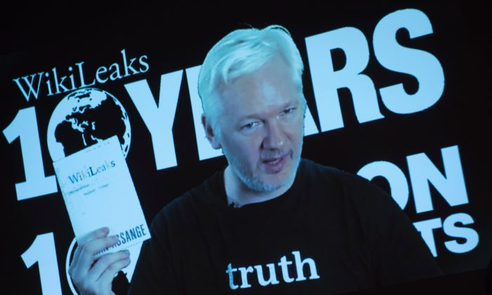 Julian Assange, founder of the online leaking platform WikiLeaks, is seen on a screen as he addresses journalists via a live video connection during a press conference on the platform's 10th anniversary in Berlin on Oct. 4, 2016. (STEFFI LOOS/AFP/Getty Images)