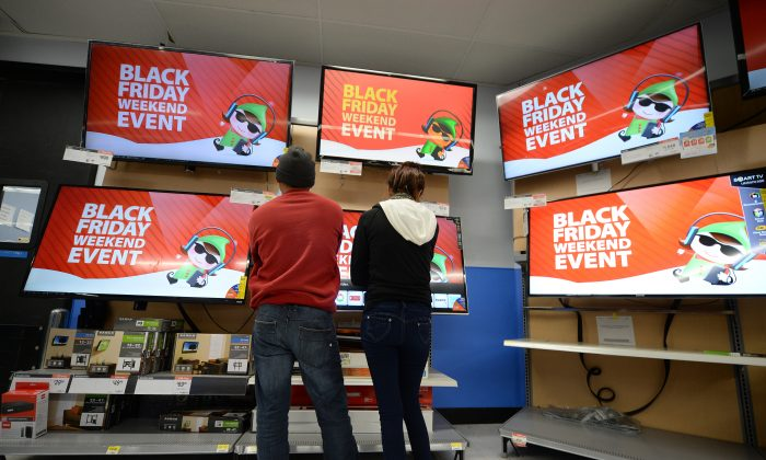 Shoppers look at televisions at a Walmart in Los Angeles (Robyn Beck/AFP/Getty Images)
