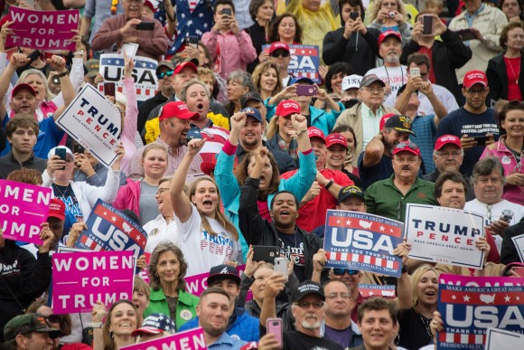 Supporters cheers as US President-elect Donald Trump speaks in Mobile, Alabama, during a 'Thank You Tour 2016' rally on Dec. 17, 2016. (JIM WATSON/AFP/Getty Images)