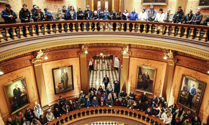 Protestors fill the rotunda of the Michigan State Capitol before the state electoral college met to cast their votes on Dec. 19, 2016 in Lansing, Michigan, United States.  The electoral college met in the afternoon and voted unanimously for Trump. Electors from all 50 states cast votes today in their respective state capitols. (Sarah Rice/Getty Images)
