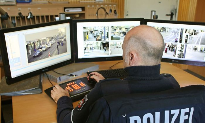 A policeman watches monitors displaying images delivered by surveillance cameras in the Marxloh district of Duisburg, western Germany, on December 21, 2016. (ROLAND WEIHRAUCH/AFP/Getty Images)