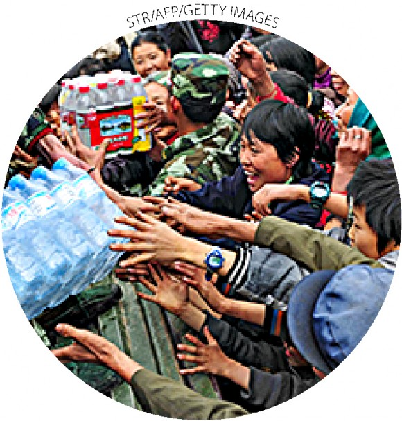 Chinese villagers collect bottled water in Qinglong, China's Yunnan Province, on April 4, 2010.