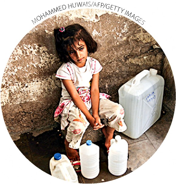 A girl rests after getting water from public taps in Sanaa, Yemen, on June 20, 2011. A study by Sanaa University reports that 70 to 80 percent of conflicts in rural areas are related to water.
