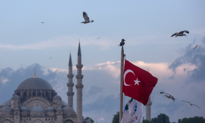 Seagulls fly over a Turkish flag in Istanbul Turkey on May 3, 2016. (Chris McGrath/Getty Images)
