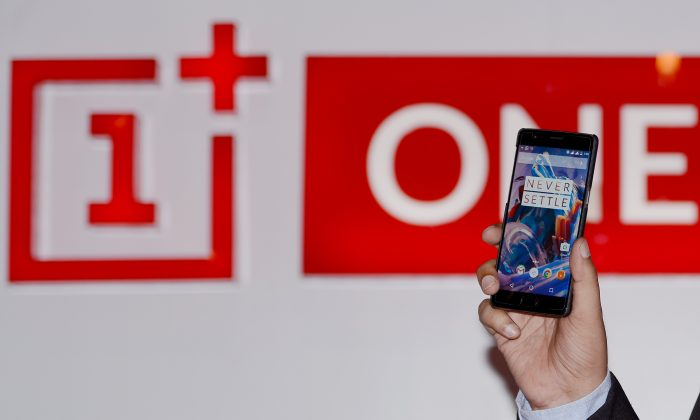 Oppo's OnePlus 3 smartphone is seen at a launch event in New Delhi June 15, 2016. (Money Sharma/AFP/Getty Images)