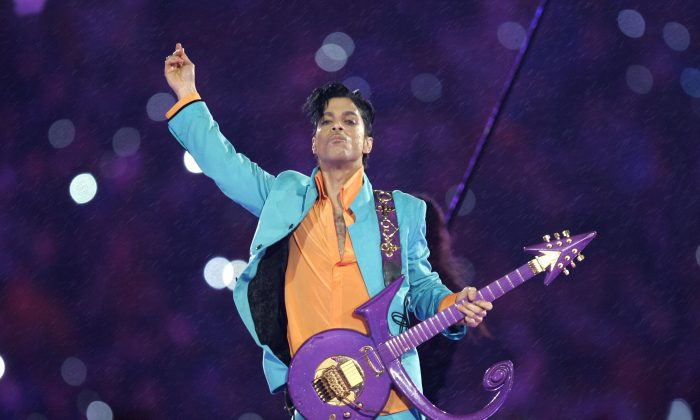 """In this Feb. 4, 2007 file photo, Prince performs during the halftime show at the Super Bowl XLI football game at Dolphin Stadium in Miami. Widely acclaimed as one of the most inventive and influential musicians of his era with hits including """"Little Red Corvette,"""" ''Let's Go Crazy"""" and """"When Doves Cry,"""" he was found dead at his home on Thursday, April 21, 2016, in suburban Minneapolis, according to his publicist. He was 57. (AP Photo/Chris O'Meara, File)"""