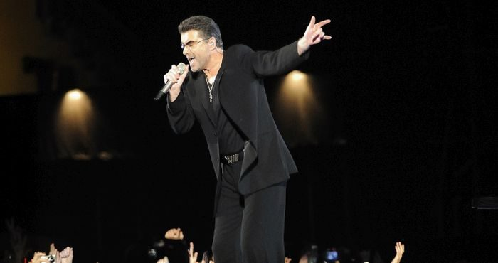 In this Monday, Dec. 1, 2008 file photo, George Michael performs at the Zayed Sports City Stadium in Abu Dhabi, United Arab Emirates, on the last stop of his 25 Live tour.   (AP Photo/Carl Abrams)
