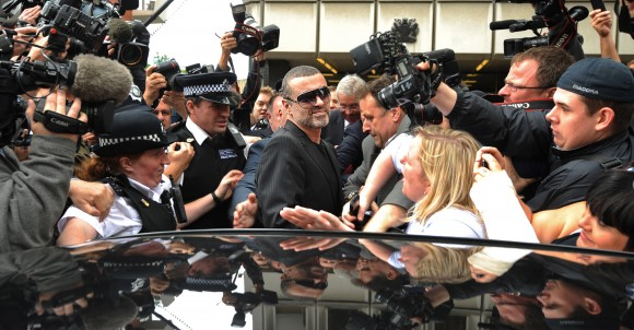 British singer George Michael (C),  leaves after appearing at Highbury Corner Magistrates Court in London on Aug. 24, 2010.  Michael pleaded guilty to possessing cannabis and driving under the influence of drugs. (BEN STANSALL/AFP/Getty Images)