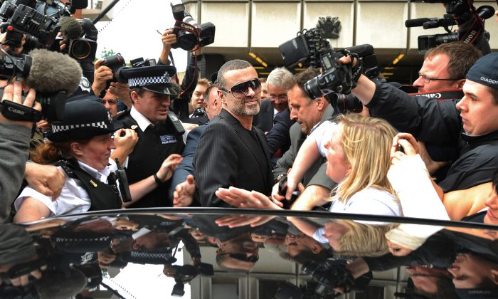 British singer George Michael (C),  leaves after appearing at Highbury Corner Magistrates Court in London on Aug. 24, 2010.  (BEN STANSALL/AFP/Getty Images)