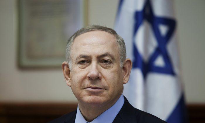 Israeli Prime Minister Benjamin Netanyahu attends a weekly cabinet meeting in Jerusalem on Dec. 25, 2016. (Dan Balilty/Pool photo via AP)