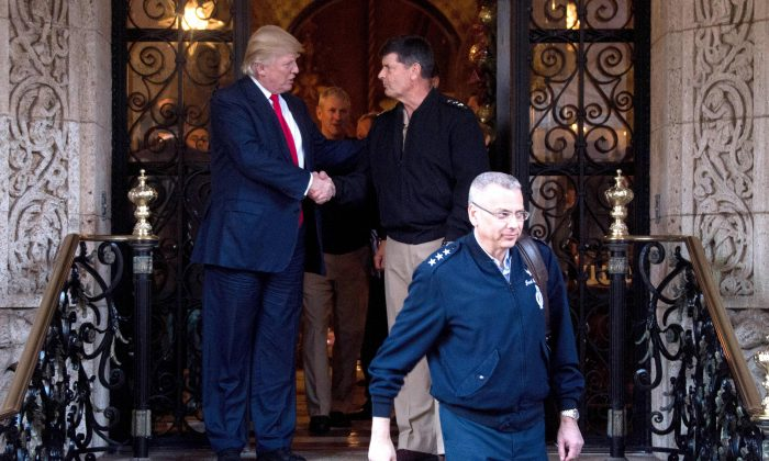 US President-elect Donald Trump (L) shakes hands with US admirals and generals from the pentagon following meetings at Mar-a-Lago in Palm Beach, Florida, on Dec. 21, 2016. (JIM WATSON/AFP/Getty Images)