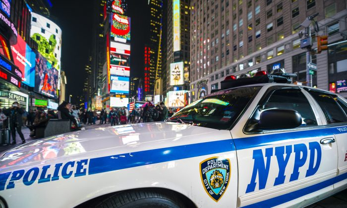 An NYPD police car stands parked in Times Square.(lazyllama/Shutterstock)