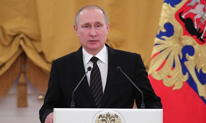 Russian President Vladimir Putin delivers a speech during a reception dedicated to the celebration of the New Year at the Kremlin in Moscow on Dec. 28, 2016. (MICHAEL KLIMENTYEV/AFP/Getty Images)