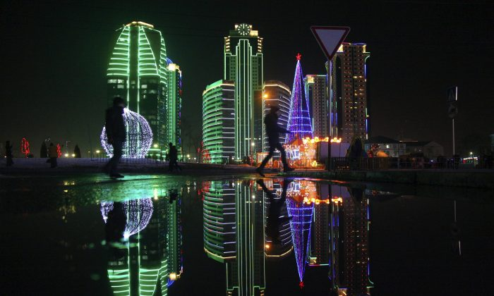 A Christmas tree and skyscrapers illuminated for the New Year celebrations are seen in downtown Grozny, the capital of Chechnya, Russia, on Dec 28, 2016. (AP Photo/Musa Sadulayev, File)