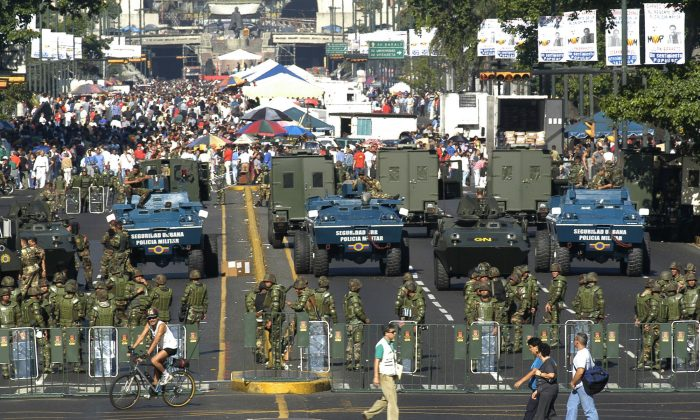 The military creates a perimeter at a government-subsidized food market in Caracas, Venezuela, in this file photo. (AP Photo/Gregorio Marrero)