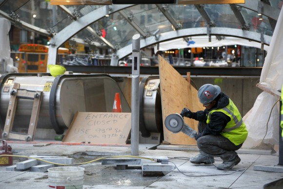 In this file photo, a construction worker cuts stone near an entrance of the unfinished Second Avenue subway in New York. (AP Photo/Seth Wenig)