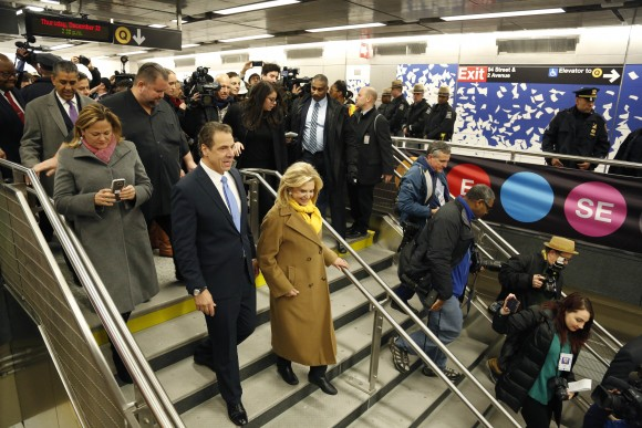 In this file photo, Andrew Cuomo, left, is surrounded by other guests and reporters as he tours the new 86th Street subway station on the Second Avenue subway in New York. (AP Photo/Seth Wenig)
