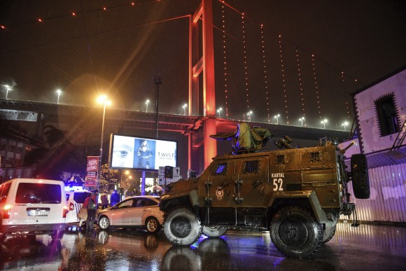 A police armoured vehicle blocks the road leading to the scene of an attack in Istanbul, early Sunday, Jan. 1, 2017. Private NTV television said more than one assailant may have been involved in the attack. The attacker or attackers are believed to have entered the nightclub in Istanbul's Ortakoy district disguised as Santa Claus, the station reported. (AP Photo)