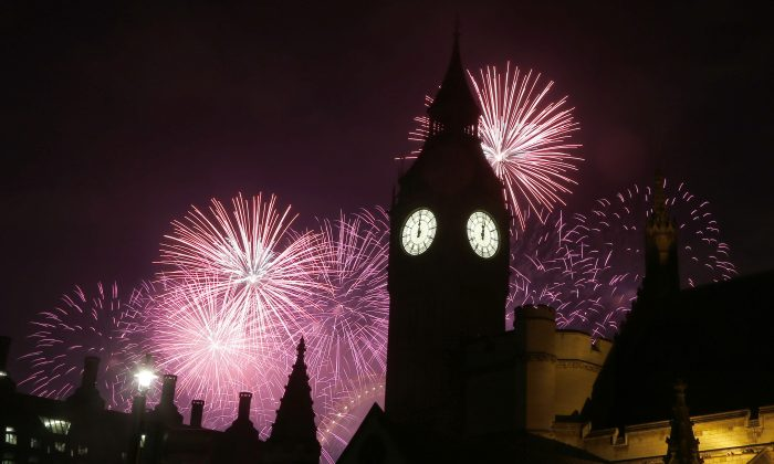 Fireworks explode over Elizabeth Tower housing the Big Ben clock to celebrate the New Year in London, on Jan. 1, 2017.(AP Photo/Frank Augstein)