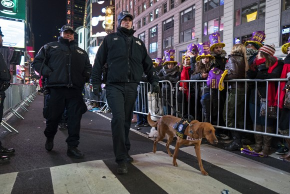 New York police officers walk among revelers who have gathered on Times Square in New York, on Dec. 31, 2016. (AP Photo/Craig Ruttle)