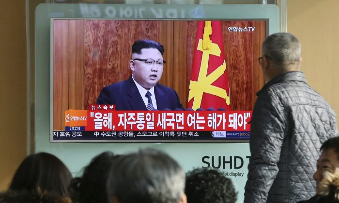 South Koreans watch a TV news program showing North Korean leader Kim Jong Un's New Year's speech, at the Seoul Railway Station in Seoul, South Korea, on Jan. 1, 2017. (AP Photo/Ahn Young-joon)