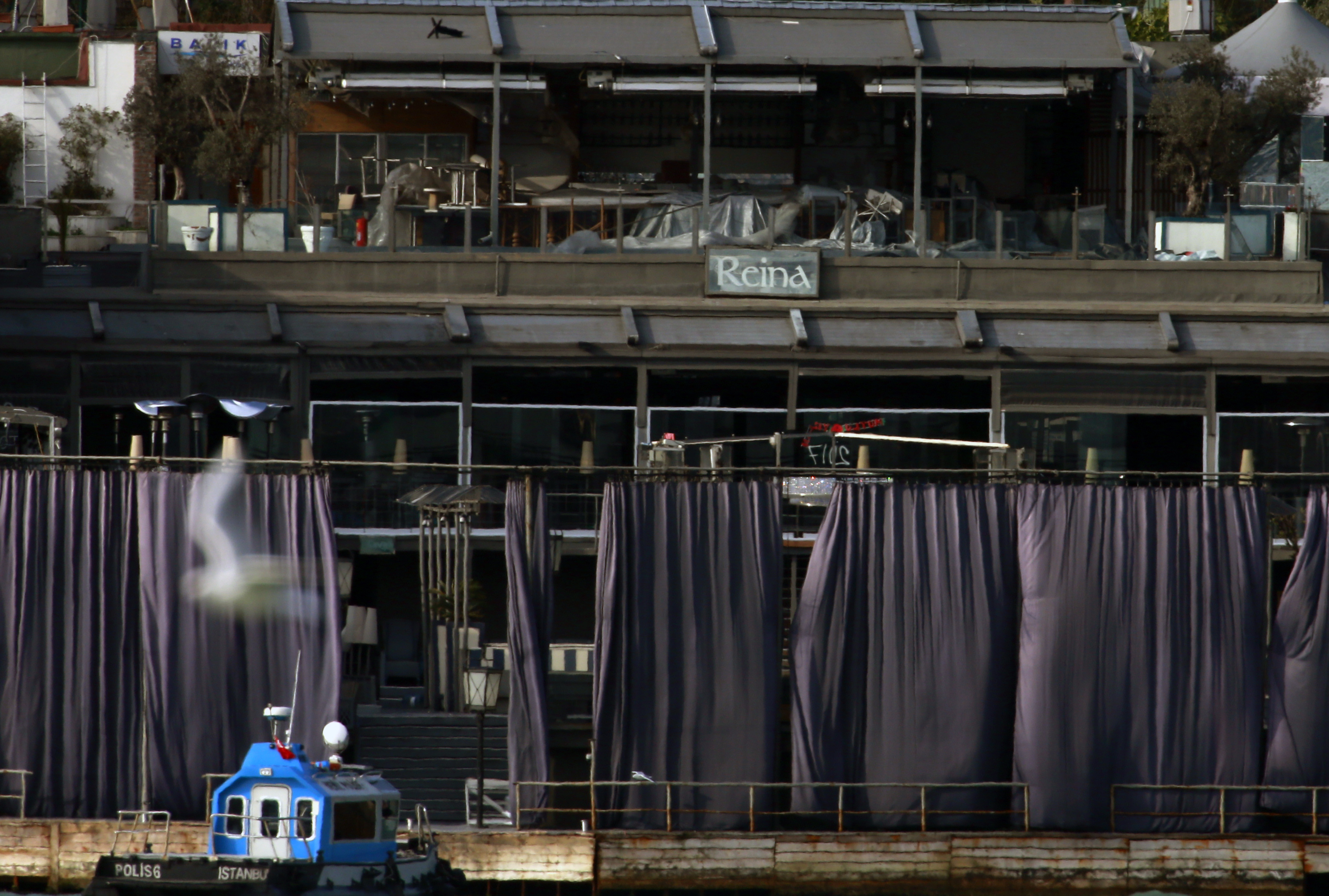 A view of a nightclub by the Bosphorus, which was attacked by a gunman overnight, in Istanbul, on New Year's Day, Sunday, Jan 1, 2017. An assailant believed to have been dressed in a Santa Claus costume and armed with a long-barrelled weapon, opened fire at the nightclub in Istanbul's Ortakoy district during New Year's celebrations, killing dozens of people and wounding dozens of others in what the province's governor described as a terror attack. (AP Photo/Emrah Gurel)