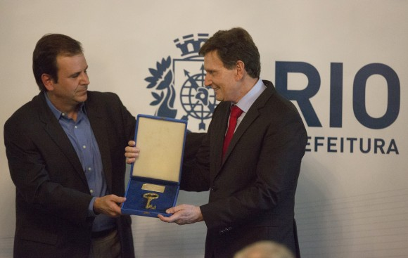 Evangelical bishop and senator Marcelo Crivella, right, receives the key of the city from the former mayor Eduardo Paes during his inauguration ceremony in Rio de Janeiro, Brazil on Jan. 1, 2017. (AP Photo/Leo Correa)