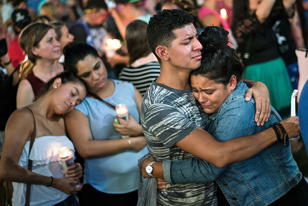 People embrace during a vigil outside the Dr. Phillips Center for the Performing Arts for the mass shooting victims at the Pulse nightclub June 13, 2016 in Orlando, Florida. The American gunman who launched a murderous assault on a gay nightclub in Orlando was radicalized by Islamist propaganda, officials said Monday, as they grappled with the worst terror attack on US soil since 9/11.   / AFP / Brendan Smialowski        (Photo credit should read BRENDAN SMIALOWSKI/AFP/Getty Images)