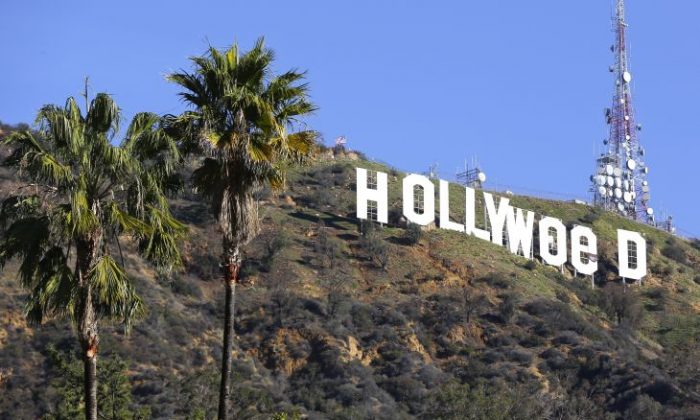 """The Hollywood sign is seen vandalized Sunday, Jan. 1, 2017. Los Angeles residents awoke New Year's Day to find a prankster had altered the famed Hollywood sign to read """"HOLLYWeeD."""" Police have also notified the city's Department of General Services, whose officers patrol Griffith Park and the area of the rugged Hollywood Hills near the sign. California voters in November approved Proposition 64, which legalized the recreational use of marijuana, beginning in 2018. (AP Photo/Damian Dovarganes)"""