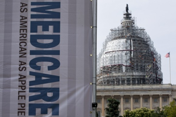 In this file photo, a sign supporting Medicare is seen on Capitol Hill in Washington, on July 30, 2015. (AP Photo/Jacquelyn Martin)