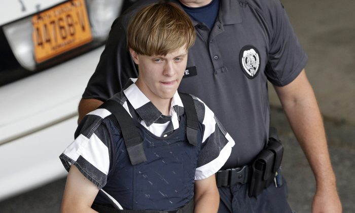 Shooting suspect Dylann Storm Roof is escorted from the Cleveland County Courthouse in Shelby, N.C., In this file photo. (AP Photo/Chuck Burton)