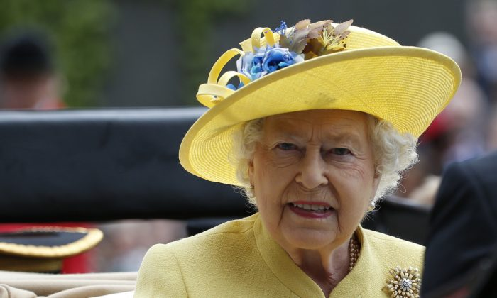 This is a Tuesday, June, 14, 2016 file photo of Britain's Queen Elizabeth II as she arrives by carriage on the first day of the Royal Ascot horse race meeting at Ascot, England.  (AP Photo/Alastair Grant/file)