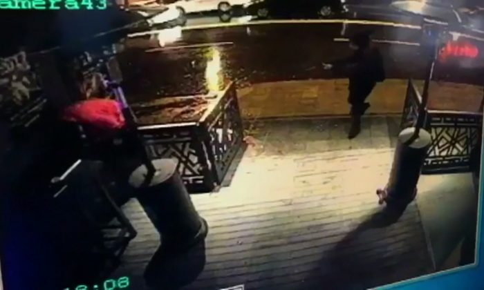 This image taken from CCTV provided by Haberturk Newspaper on Jan. 1, 2017 shows the attacker, armed with a long-barrelled weapon, shooting his way into the Reina nightclub in Istanbul, Turkey on Sunday morning. (CCTV/Haberturk Newspaper via AP)