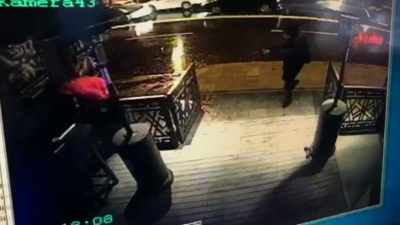 The attacker, armed with a long-barrelled weapon, shooting his way into the Reina nightclub in Istanbul, Turkey. (CCTV/Haberturk Newspaper via AP)