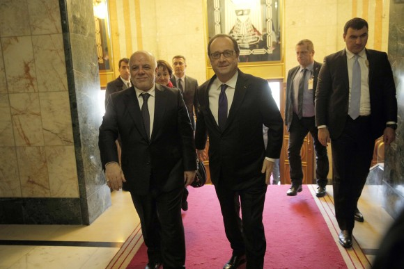 Iraq's Prime Minister Haider al-Abadi, left, greets French President Francois Hollande prior to their meeting in Baghdad, Iraq, Monday, Jan. 2, 2017. Hollande is in Iraq for a one-day visit. (AP Photo/Christophe Ena, Pool)