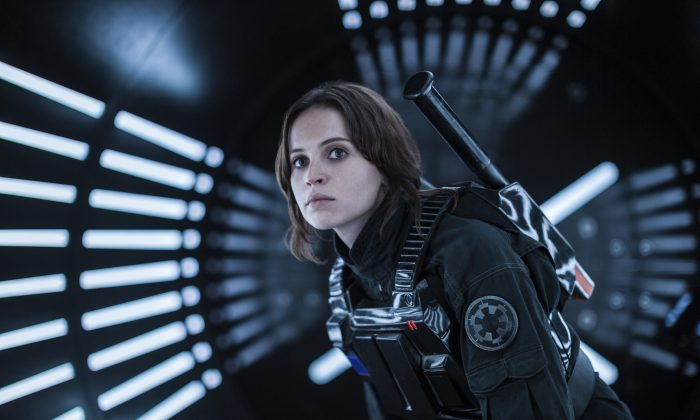 """This file image released by Lucasfilm Ltd. shows Felicity Jones as Jyn Erso in a scene from, """"Rogue One: A Star Wars Story."""" The """"Star Wars"""" spinoff """"Rogue One"""" has led the box office for the third straight week, taking in an estimated $64.3 million over the four-day New Year's weekend. (Jonathan Olley/Lucasfilm Ltd. via AP, File)"""