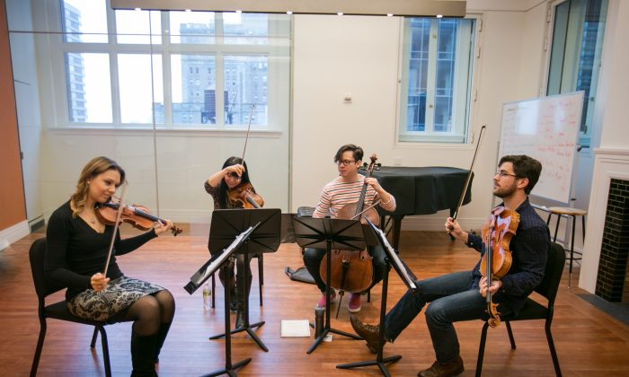 The Attacca Quartet rehearses in New York City on Dec. 7, 2016. (Benjamin Chasteen/The Epoch Times)
