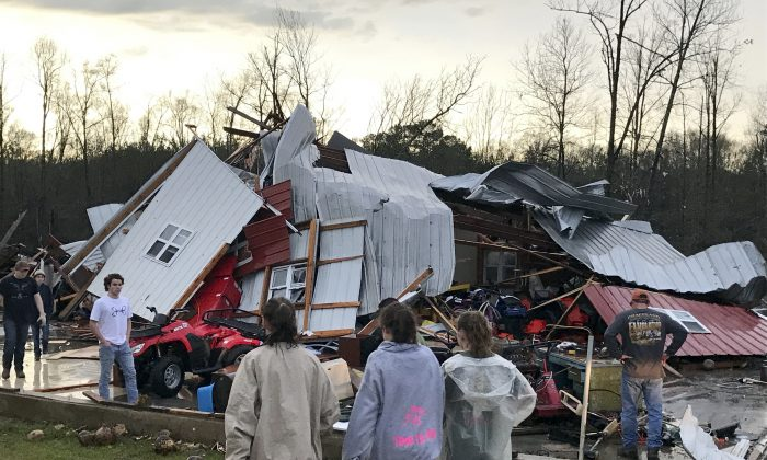 People examine a barn that was destroyed during a storm south of Mount Olive, Miss., on Jan. 2, 2017. (Ryan Moore/WDAM-TV via AP)