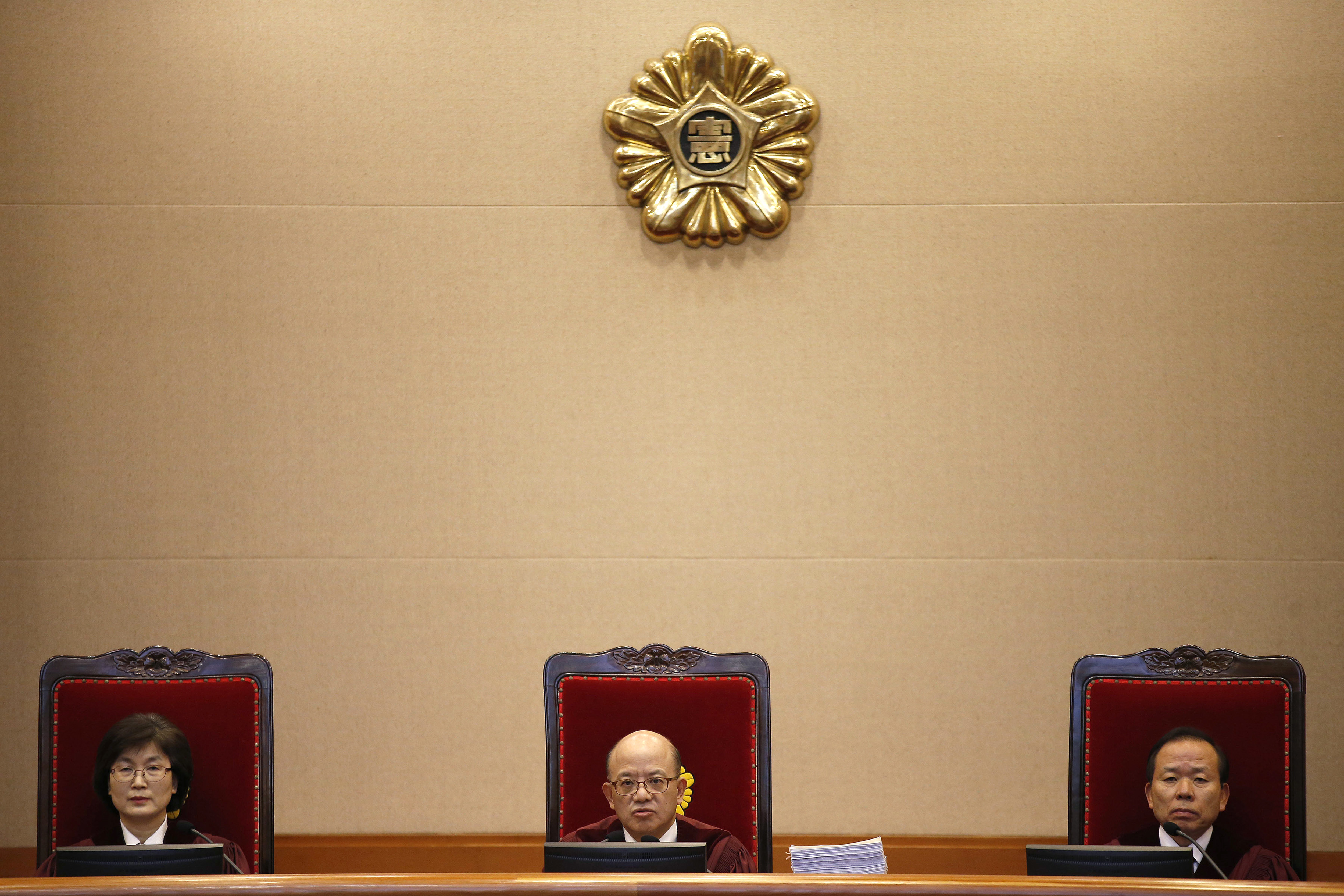 Chief Justice Park Han-chul, center, presides over the first hearing arguments for South Korean President Park Geun-hye's impeachment trial at the Constitutional Court in Seoul, South Korea, Tuesday, Jan 3, 2017. (Kim Hong-Ji/Pool Photo via AP)