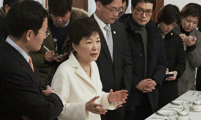 impeached South Korean President Park Geun-hye, second from left, during a meeting with a selected group of reporters at the presidential house in Seoul on Jan. 3, 2016. (The South Korean Presidential House via AP, File)