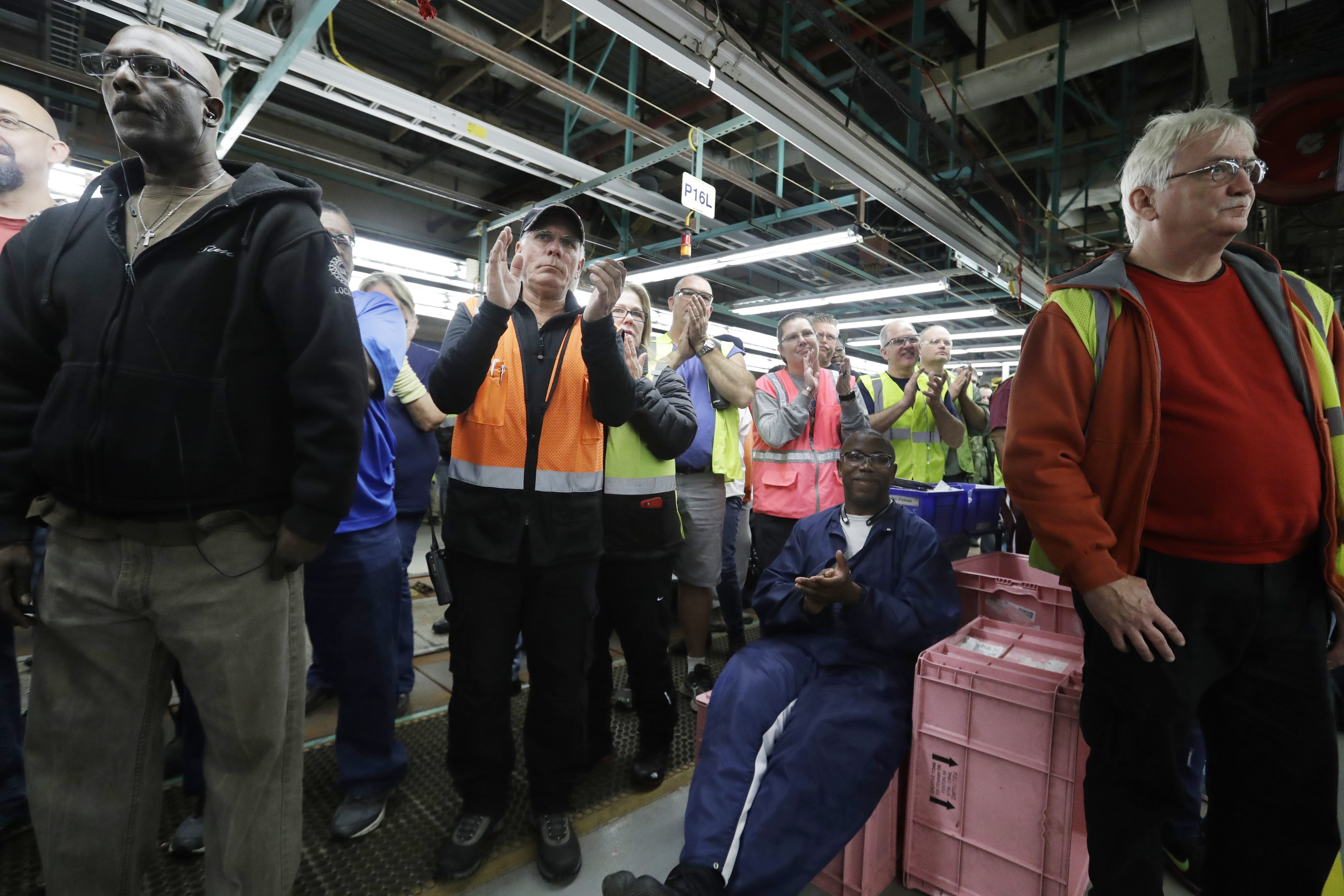 Flat Rock Assembly employees clap as Ford President and CEO Mark Fields addresses the auto plant in Flat Rock, Mich., on Jan. 3, 2017. (AP Photo/Carlos Osorio)
